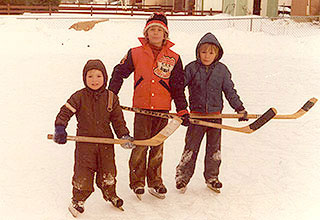 Image of Wayne as a young child in backyard rink.